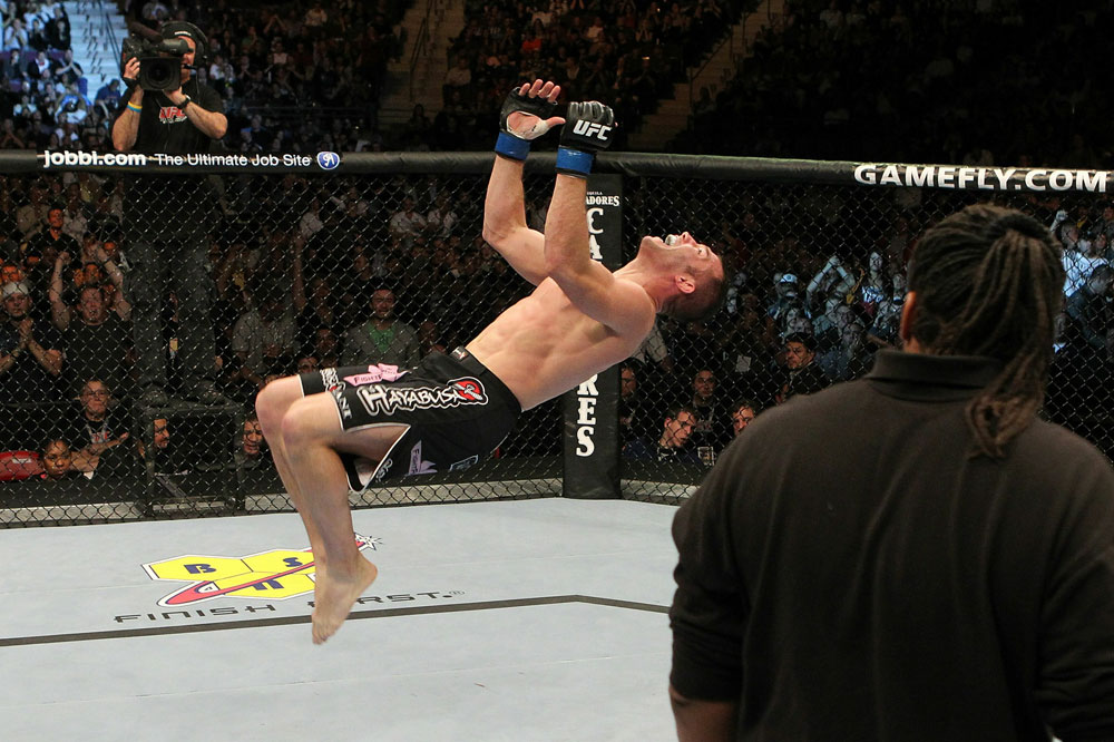 Brian Foster celebrates with a backflip after his victory over Matt Brown at UFC 123. (Photo via UFC.com)