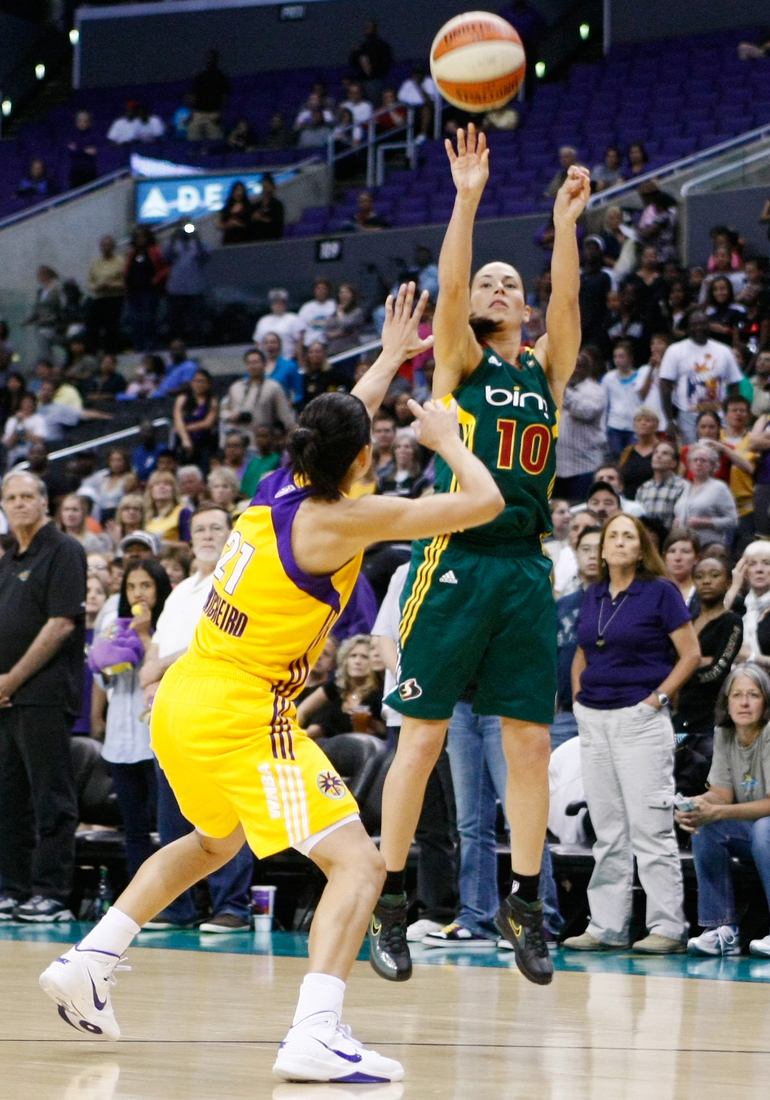 """Los Angeles Sparks veteran Ticha Penicheiro has been a model of point guard """"purity"""" during her career, but we can probably forgive Seattle Storm point guard Sue Bird for her more """"impure"""" tendencies. <em>Photo by Craig Bennett/112575 Media.</em>"""