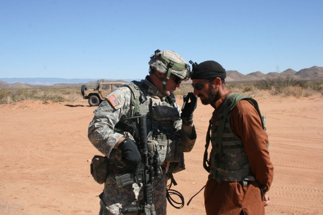 Army soldiers using cell phone