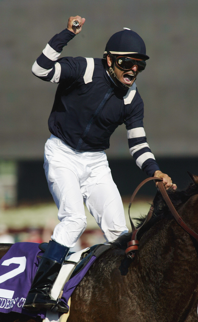 Patrick Valenzuela aboard Adoration celebrates the victory in the 2003 Breeders' Cup Distaff on Saturday, October 25, 2003 at Santa Anita Park in Arcadia, California. (Photo by Jeff Golden/Getty Images)