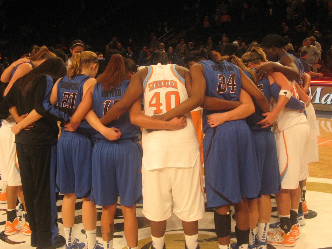 DePaul Blue Demons and Tennessee Lady Vols players meet at center court after their meeting at the Maggie Dixon Classic at Madison Square Garden on Sunday. <em>Photo by Ray Floriani. </em>