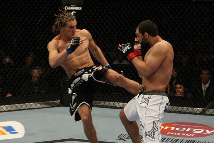 Ricardo Funch (left) kicks Johny Hendricks at UFC 107. (Photo via UFC.com)