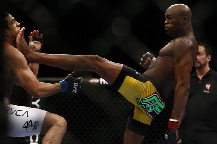 Anderson Silva crushes Vitor Belfort with a front kick at UFC 126. (Photo by Esther Lin via MMA Fighting)