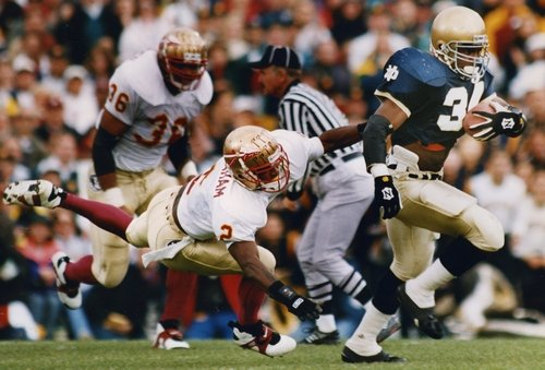 Notre Dame's Ray Zellars eludes Florida State's Clifton Abraham in the 1993 contest between the Irish and the Seminoles in South Bend, Ind. Photo AP.