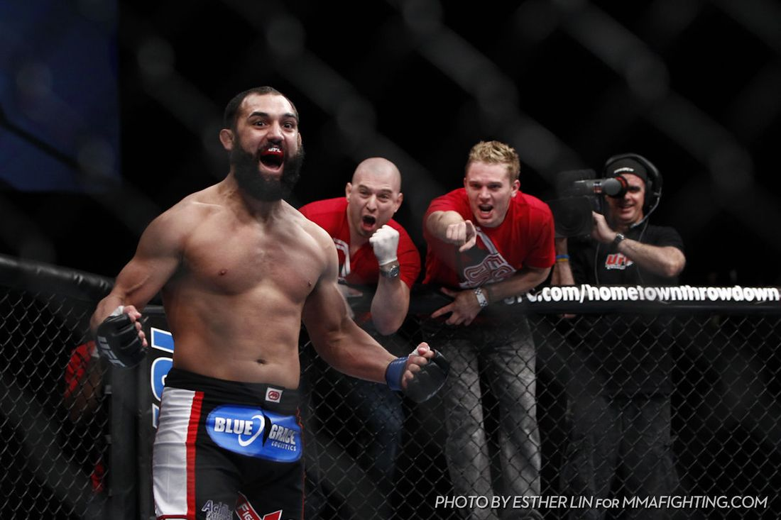 """Johny Hendricks celebrates beating Jon Fitch at UFC 141. Photo by Esther Lin for <a href=""""http://www.mmafighting.com/photos/"""" target=""""new"""">MMA Fighting</a>."""