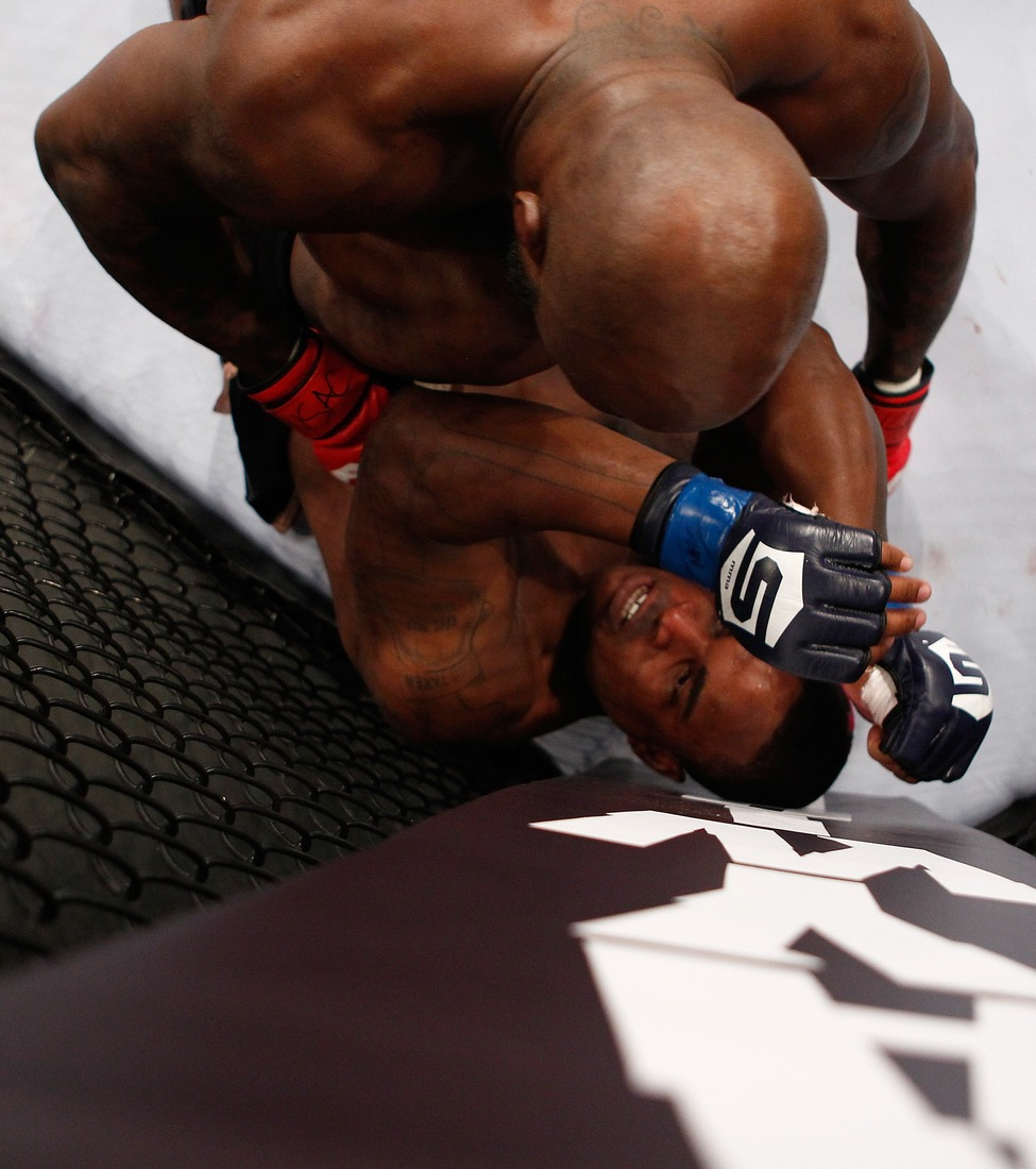 LAS VEGAS - JANUARY 07: King Mo Lawal (top) throws punches at Lorenz Larkin (bottom) during the Strikeforce event at the Hard Rock Hotel and Casino on January 7, 2012 in Las Vegas, Nevada. (Photo by Esther Lin/Forza LLC/Forza LLC via Getty Images)