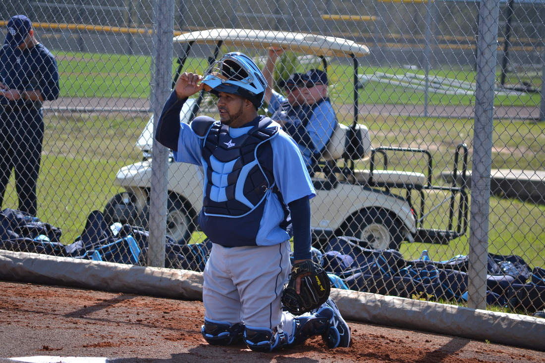 (John Gregg---Rays Digest) Jose Molina catching a bullpen for pitcher Matt Bush during the Rays first spring training workout for pitchers and catchers on 2/21/12.