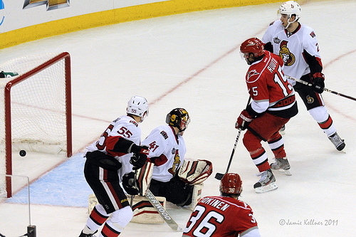 Hurricanes forward Tuomo Ruutu tips in a shot from defenseman Jay Harrison for a rare overtime win against the Ottawa Senators in Raleigh on December 23, 2011 (author's photo).