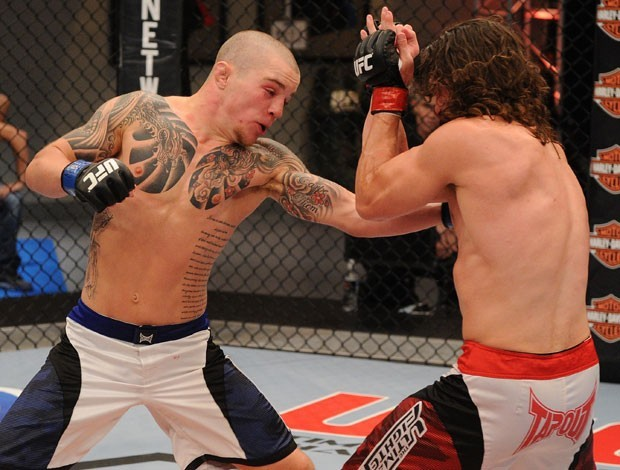 Andy Ogle punches Mike Rio at The Ultimate Fighter (TUF) Gym during their fight in Las Vegas, Nevada, on Fri., May 4, 2012. Photo via Getty Images.