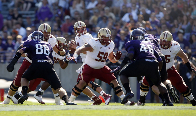 Sep 15, 2012; Evanston, IL, USA; Boston College Eagles quarterback Chase Rettig (11) drops back to pass against the Northwestern Wildcats during the first quarter at Ryan Field. Jerry Lai-US PRESSWIRE