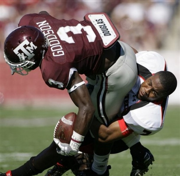 Darcel McBath doesn't need a helmet to make tackles...A real badass!