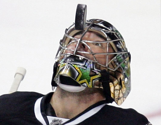 Marty always has his eyes on the puck and how has his eyes on the greatest #35 in Stars history.  (Tim Sharp/AP Photo)
