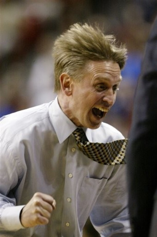 Former Wyoming coach Steve McClain reacts during the second half of a game against Air Force during the 2007 Mountain West tournament. Wyoming won 67-62.