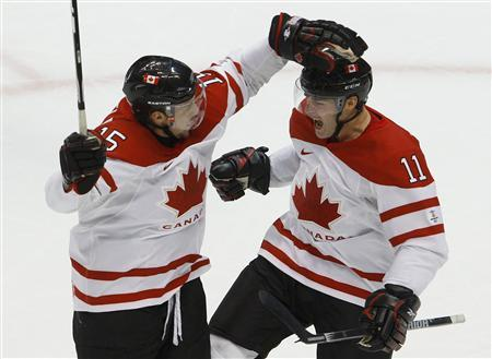 Patrick Marleau (11) of Canada celebrates his goal against Slovakia with Dany Heatley (15) in their mens's play-offs semifinals hockey game at the Vancouver 2010 Winter Olympics February 26, 2010.  REUTERS/Todd Korol