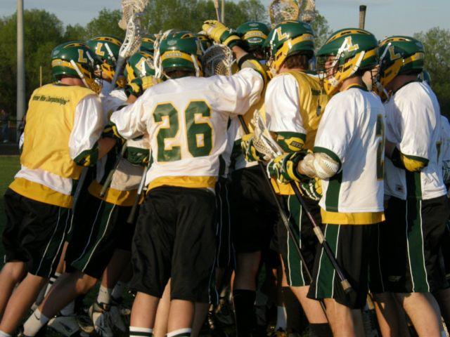The Langley boys lacrosse team huddles before a playoff match. (via DigitialSports)