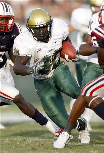 """Ben Williams against FAU in 2007. Odds are he gained a lot of yards on this run.via <a href=""""http://www.victorysportsagency.com/images/23_ben_williams_4.jpg"""">www.victorysportsagency.com</a>"""