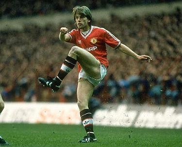 Jesper Olse in action for United.