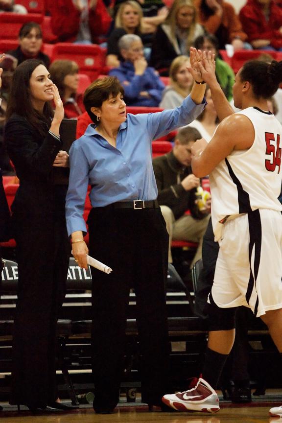 """Seattle University coach Joan Bonvicini high-fives center Tatiana Heck. <em>Photo via <a href=""""http://jlindstr.smugmug.com/photos/724253835_eeB9L-X2.jpg"""">jlindstr.smugmug.com</a></em>"""