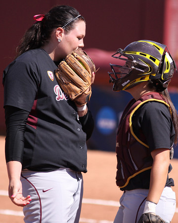 Dallas Escobedo (left) consults with catcher Kaylyn Castillo during a regional game against Long Beach State on May 21, 2011. Photo courtesy of Steve Rodriguez.