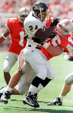"""Wasean Tait could've been the fiercest tailback in recent memory before his career was cut short by injury. <em>(Photo via <a href=""""http://ncaabbs.com/archive/index.php/thread-114918.html"""">ncaabbs.com</a>)</em>"""
