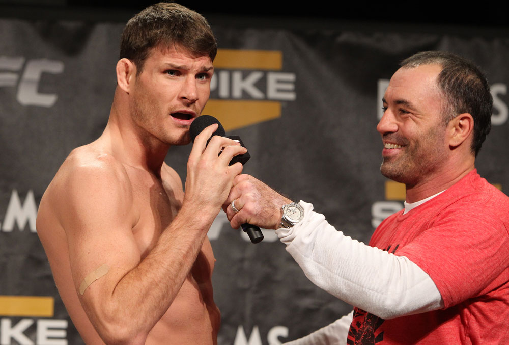 UFC middleweight Michael Bisping tells the crowd at the TUF 14 Finale weigh-ins to f*ck off in advance of his main event bout against Jason Miller tomorrow night. <em>Photo by Josh Hedges/Zuffa LLC/Zuffa LLC via Getty Images.</em>