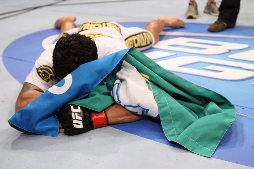 RIO DE JANEIRO, BRAZIL - JANUARY 14: Thiago Tavares celebrates after defeating Sam Stout in a lightweight bout during UFC 142 at HSBC Arena on January 14, 2012 in Rio de Janeiro, Brazil. (Photo by Josh Hedges/Zuffa LLC/Zuffa LLC via Getty Images)