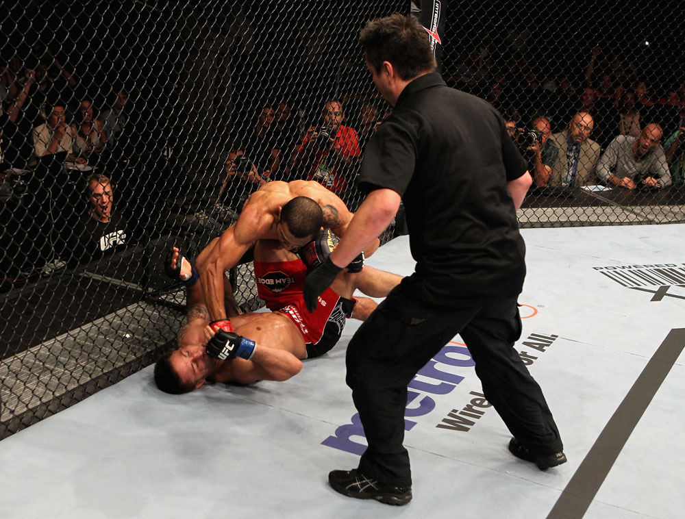 RIO DE JANEIRO, BRAZIL - JANUARY 14: Jose Aldo punches Chad Mendes on the ground in a featherweight bout during UFC 142 at HSBC Arena on January 14, 2012 in Rio de Janeiro, Brazil. (Photo by Josh Hedges/Zuffa LLC/Zuffa LLC via Getty Images).