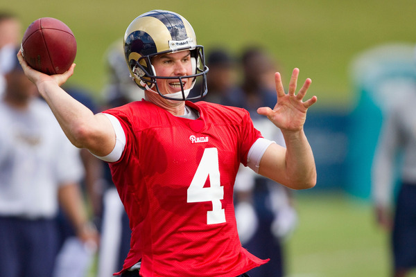 A.J. Feeley #4 of the St. Louis Rams passes during training camp at the Russell Athletic Training Facility. Feeley's the Rams starting QB...for now.