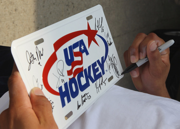 LAKE PLACID NY - AUGUST 03: Team USA players sign autographs upon their arrival for a game against Team Sweden at the USA Hockey National Evaluation Camp game on August 3 2010 in Lake Placid New York. (Photo by Bruce Bennett/Getty Images)