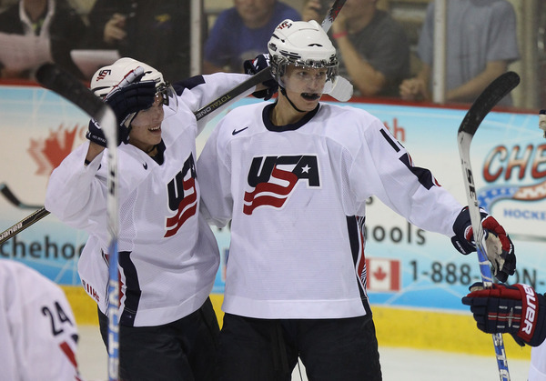 LAKE PLACID NY - AUGUST 04: Nick Bjugstad #15 (R) of Team USA scores at 7:16 of the first period against Team Finland at the USA Hockey National Evaluation Camp on August 4 2010 in Lake Placid New York.  (Photo by Bruce Bennett/Getty Images)