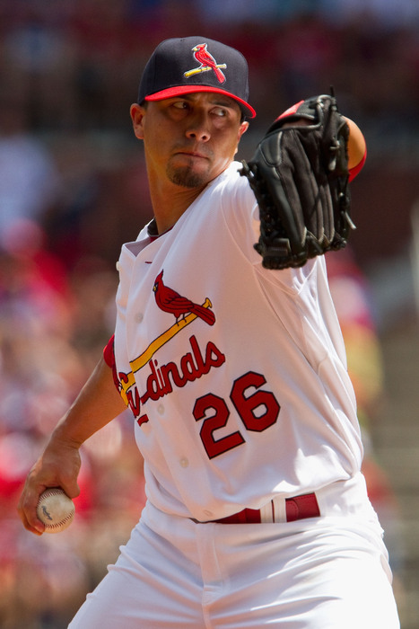 ST. LOUIS - AUGUST 15: Starting pitcher Kyle Lohse #26 of the St. Louis Cardinals throws against the Chicago Cubs at Busch Stadium on August 15, 2010 in St. Louis.  (Photo by Dilip Vishwanat/Getty Images)