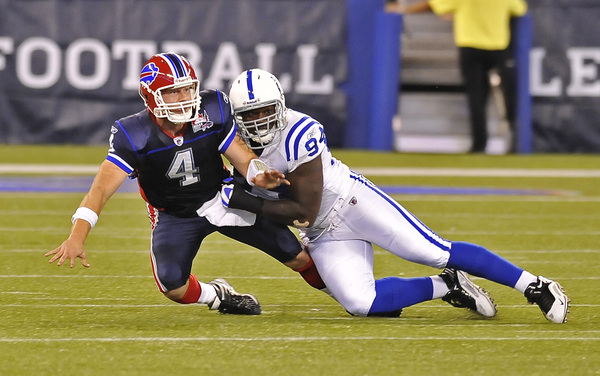 TORONTO - AUGUST 19:  Brian Brohm #4 of the Buffalo Bills is tackled by Ervin Baldwin #94 of the Indianapolis Colts during game action August 19 2010 at the Rogers Centre in Toronto Ontario Canada. (Photo by Brad White/Getty Images)