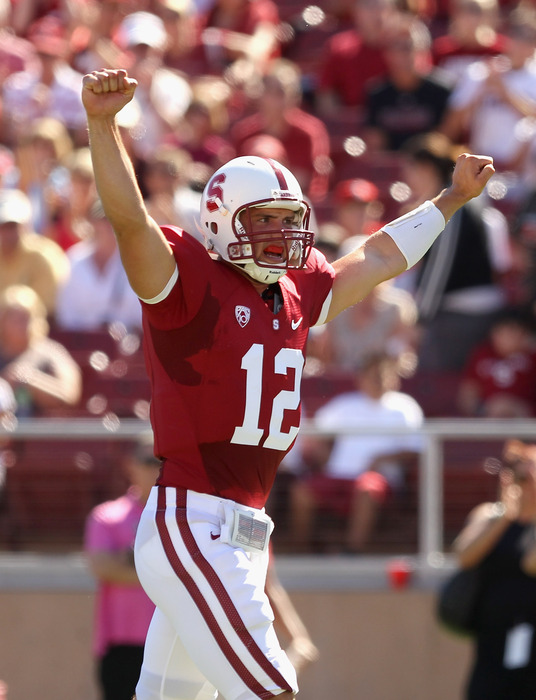 PALO ALTO CA - SEPTEMBER 04:  Andrew Luck #12 of the Stanford Cardinal celebrates after they scored a touchdown against the Sacramento State Hornets at Stanford Stadium on September 4 2010 in Palo Alto California.  (Photo by Ezra Shaw/Getty Images)