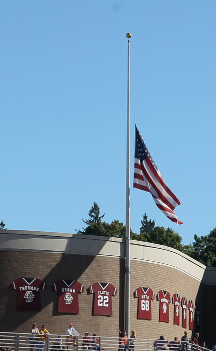 The flag is raised to  half staff in honor of the 9/11 attacks during a game at Boston College