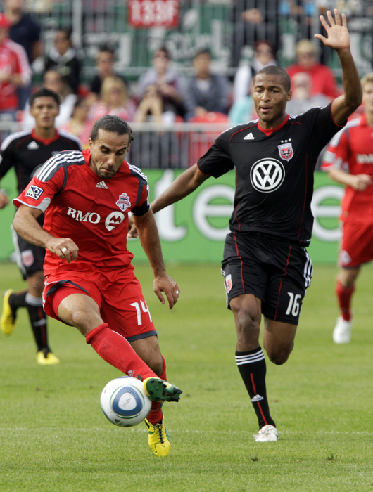 TORONTO CANADA - SEPTEMBER 28: Dwayne De Rosario #14 of Toronto FC battles for the ball with Jordan Graye #16 of D.C. United during a MLS game at BMO Field September 11 2010 in Toronto Ontario Canada. (Photo by Abelimages/Getty Images)