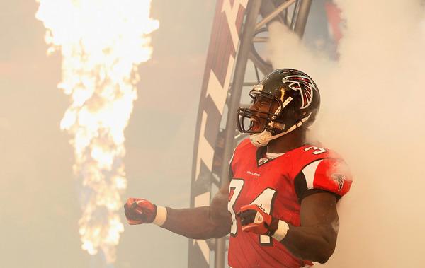 ATLANTA - SEPTEMBER 19:  Ovie Mughelli #34 of the Atlanta Falcons enters the field to face the Arizona Cardinals at Georgia Dome on September 19 2010 in Atlanta Georgia.  (Photo by Kevin C. Cox/Getty Images)