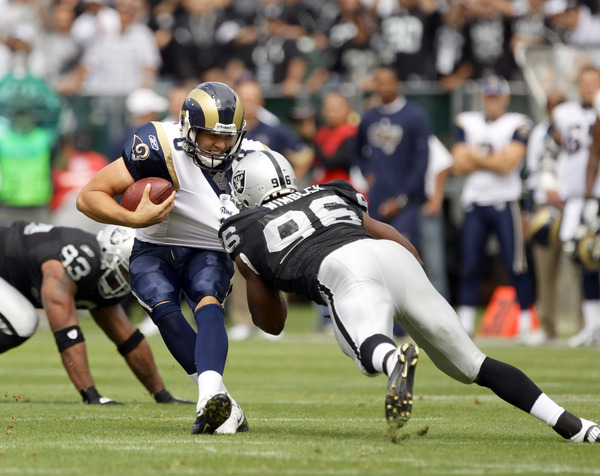 OAKLAND CA - SEPTEMBER 19:  Sam Bradford #8 of the St. Louis Rams is sacked by Kamerion Wimbley #96 of the Oakland Raiders at the Oakland-Alameda County Coliseum on September 19 2010 in Oakland California.  (Photo by Ezra Shaw/Getty Images)