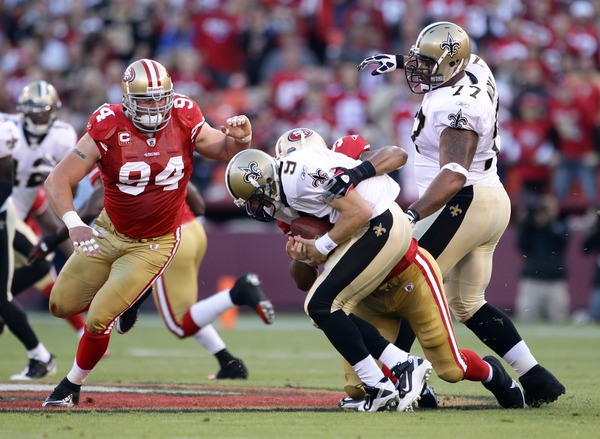 SAN FRANCISCO - SEPTEMBER 20:  Drew Brees #9 of the New Orleans Saints is sacked by Ahmad Brooks #55 of the San Francisco 49ers at Candlestick Park on September 20 2010 in San Francisco California.  (Photo by Ezra Shaw/Getty Images)