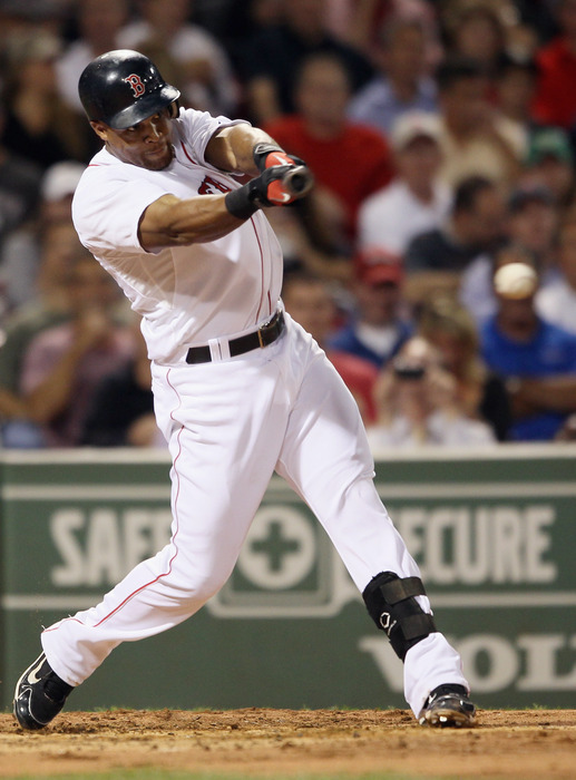 BOSTON - SEPTEMBER 22:  Adrian Beltre #29 of the Boston Red Sox hits a single in the second inning against the Baltimore Orioles on September 22 2010 at Fenway Park in Boston Massachusetts.  (Photo by Elsa/Getty Images)