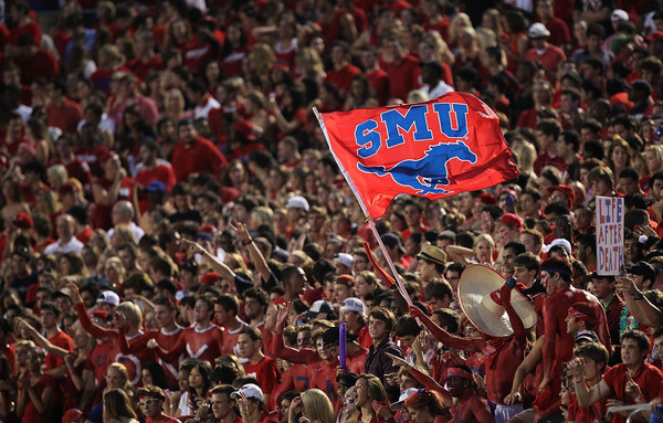 DALLAS - SEPTEMBER 24:  Fans of the SMU Mustangs wave a flag during play against the TCU Horned Frogs at Gerald J. Ford Stadium on September 24 2010 in Dallas Texas.  (Photo by Ronald Martinez/Getty Images)