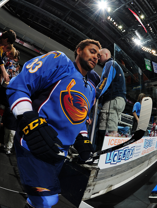 ATLANTA - SEPTEMBER 25: Dustin Byfuglien #33 of the Atlanta Thrashers heads to the ice to play against the Carolina Hurricanes at Philips Arena on September 25 2010 in Atlanta Georgia. (Photo by Scott Cunningham/Getty Images)