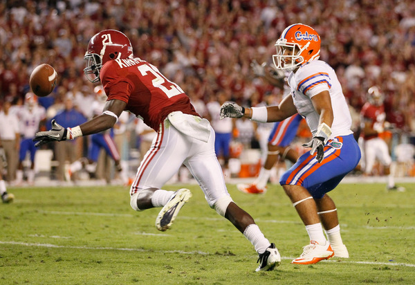 TUSCALOOSA AL - OCTOBER 02:  Dre Kirkpatrick #21 of the Alabama Crimson Tide intercepts a pass intended for Trey Burton #8 of the Florida Gators at Bryant-Denny Stadium on October 2 2010 in Tuscaloosa Alabama.  (Photo by Kevin C. Cox/Getty Images)
