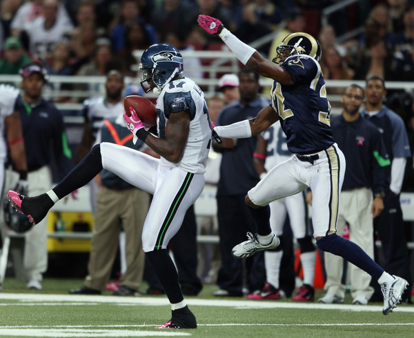 ST. LOUIS - OCTOBER 03:  Mike Williams #17 of the Seattle Seahawks makes the catch as Bradley Fletcher #32 of the St. Louis Rams defends.