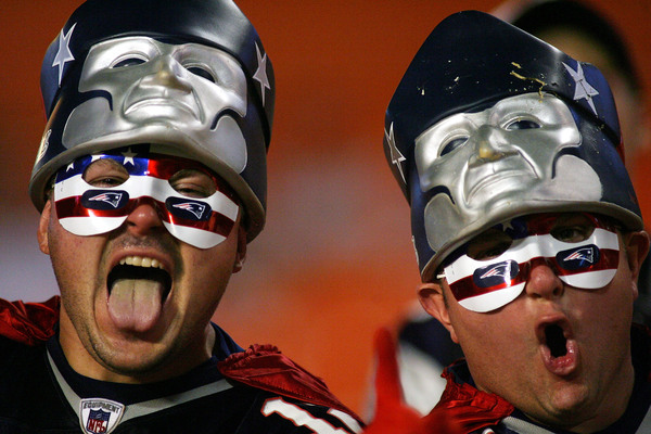 MIAMI - OCTOBER 04:  New England Patriots fans cheer during warm up against the Miami Dolphins at Sun Life Stadium on October 4 2010 in Miami Florida.  (Photo by Marc Serota/Getty Images)