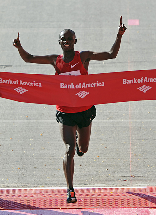 CHICAGO - OCTOBER 10:  Sammy Wanjiru of Kenya raises his arms in victory as he wins the Bank of America Chicago Marathon in a time of 2:06:24 on October 10, 2010 in Chicago, Illinois. (Photo by Jim Prisching/Getty Images)