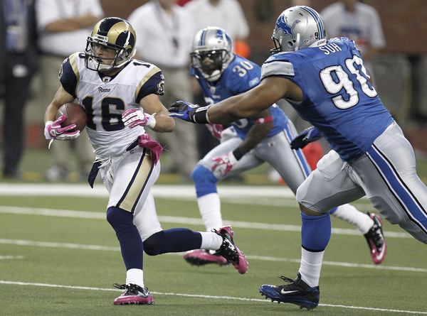 Danny Amendola #16 of the St. Louis Rams tries to outrun the tackle of Ndamukong Suh #90 of the Detroit Lions.