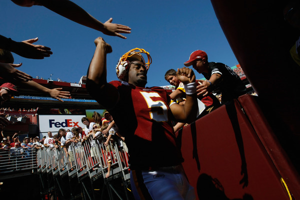 LANDOVER, MD - OCTOBER 10:  Quarterback Donovan McNabb #5 of the Washington Redskins greets fans before playing against the Green Bay Packers at FedExField on October 10, 2010 in Landover, Maryland.  (Photo by Win McNamee/Getty Images)