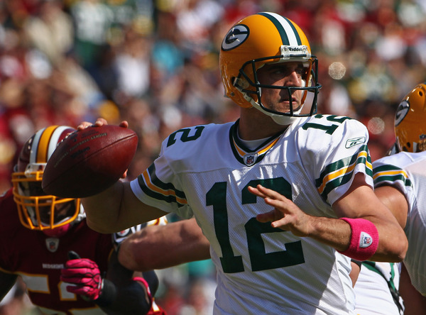 A recent concussion makes Green Bay Packers quarterback Aaron Rodgers someone you should consider trading. (Photo by Win McNamee/Getty Images)