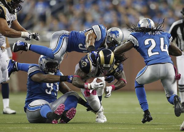 Steven Jackson of the St. Louis Rams runs for a short gain in the third quarter.