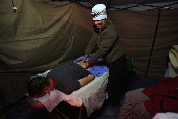 Massage therapists are a fixture at endurance sports events such as the 24 hour Moab Mountain Bike Race.